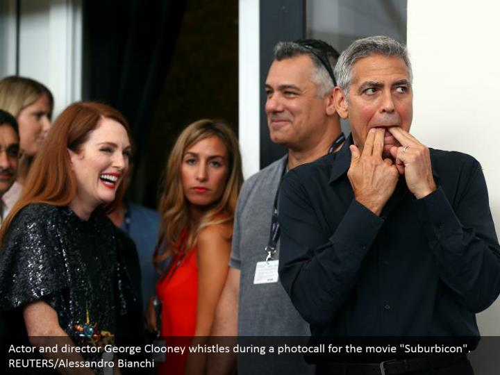 "Actor and director George Clooney whistles during a photocall for the movie ""Suburbicon"". REUTERS/Alessandro Bianchi"