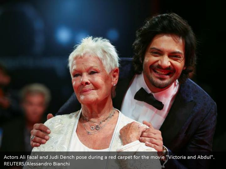 "Actors Ali Fazal and Judi Dench pose during a red carpet for the movie ""Victoria and Abdul"". REUTERS/Alessandro Bianchi"