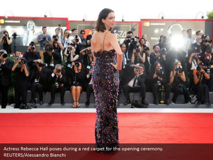 Actress Rebecca Hall poses during a red carpet for the opening ceremony. REUTERS/Alessandro Bianchi