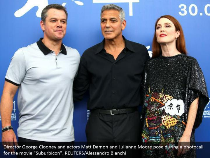 "Director George Clooney and actors Matt Damon and Julianne Moore pose during a photocall for the movie ""Suburbicon"". REUTERS/Alessandro Bianchi"