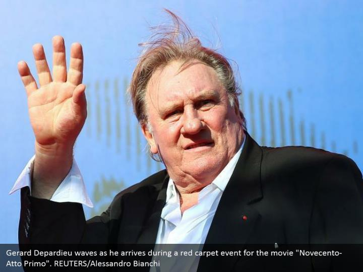 "Gerard Depardieu waves as he arrives during a red carpet event for the movie ""Novecento- Atto Primo"". REUTERS/Alessandro Bianchi"