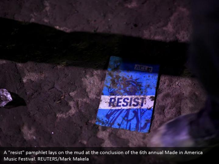 """A """"resist"""" pamphlet lays on the mud at the conclusion of the 6th annual Made in America Music Festival. REUTERS/Mark Makela"""