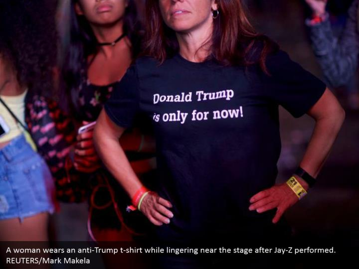 A woman wears an anti-Trump t-shirt while lingering near the stage after Jay-Z performed. REUTERS/Mark Makela