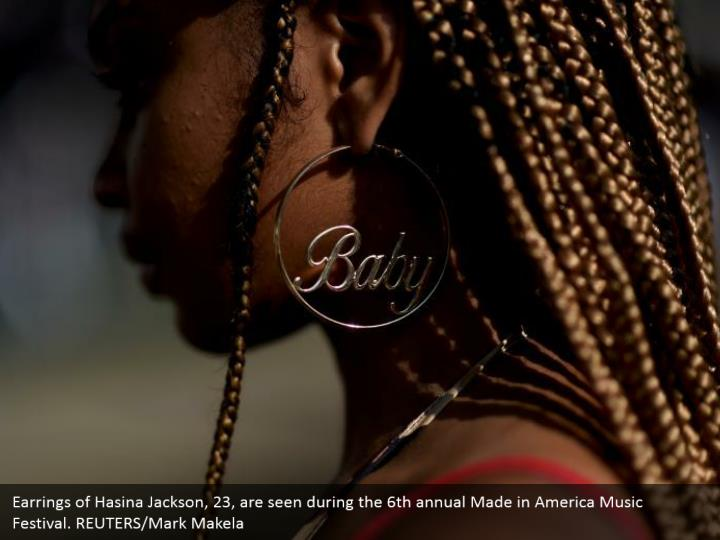 Earrings of Hasina Jackson, 23, are seen during the 6th annual Made in America Music Festival. REUTERS/Mark Makela