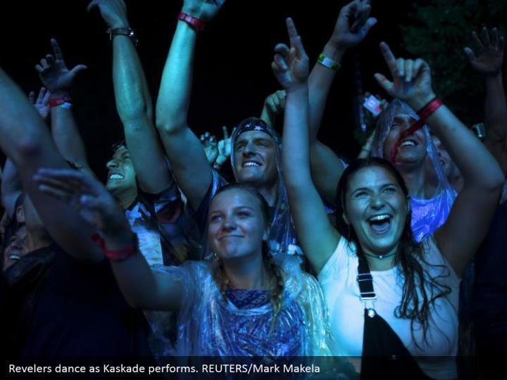 Revelers dance as Kaskade performs. REUTERS/Mark Makela