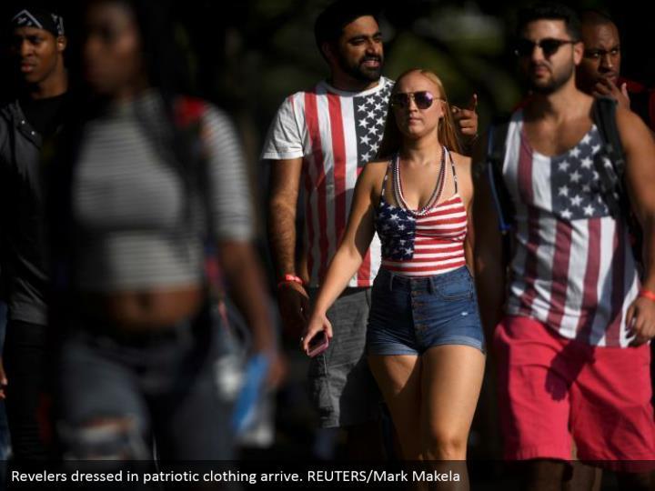 Revelers dressed in patriotic clothing arrive. REUTERS/Mark Makela