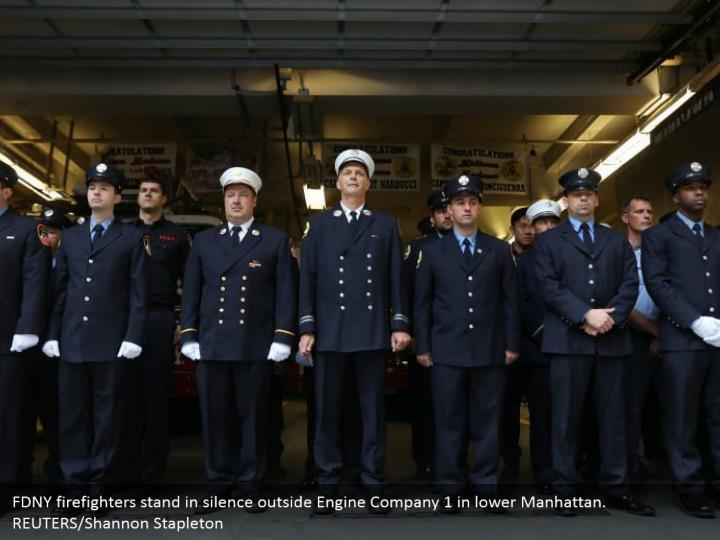 FDNY firefighters stand in silence outside Engine Company 1 in lower Manhattan. REUTERS/Shannon Stapleton