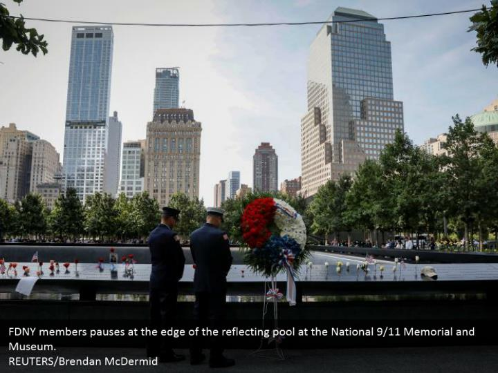 FDNY members pauses at the edge of the reflecting pool at the National 9/11 Memorial and Museum.  REUTERS/Brendan McDermid