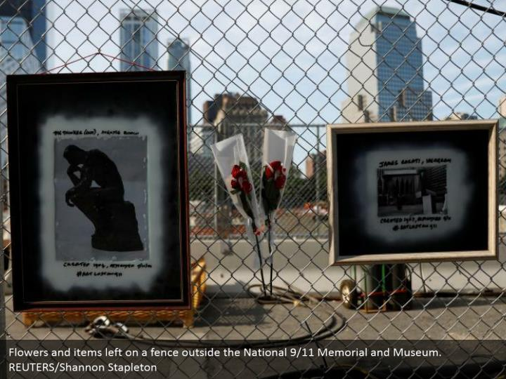 Flowers and items left on a fence outside the National 9/11 Memorial and Museum. REUTERS/Shannon Stapleton