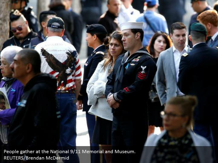 People gather at the National 9/11 Memorial and Museum.  REUTERS/Brendan McDermid