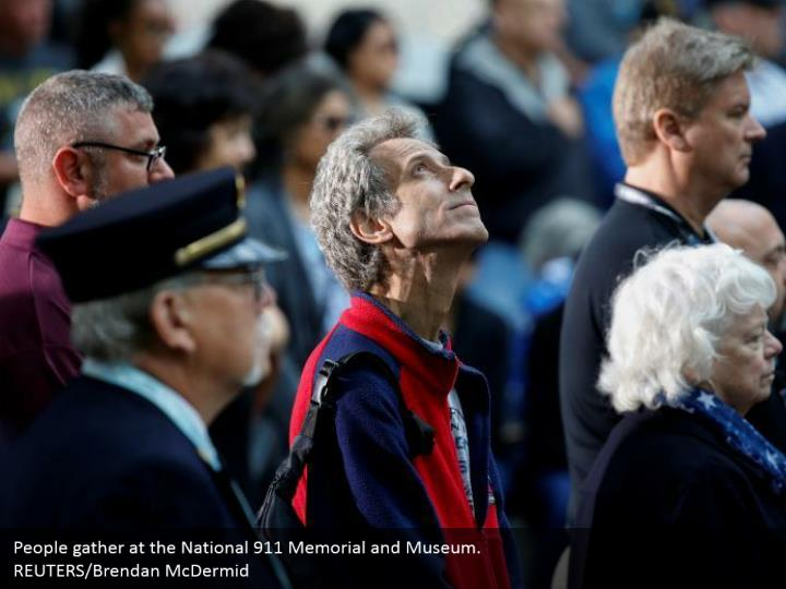 People gather at the National 911 Memorial and Museum.  REUTERS/Brendan McDermid