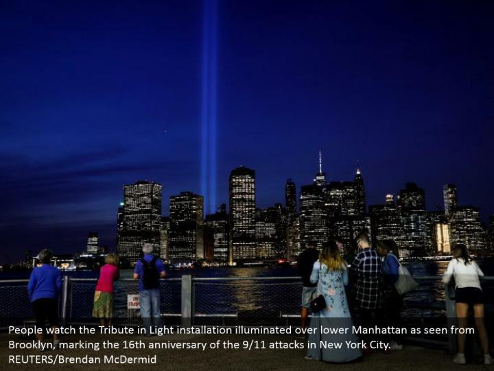 People watch the tribute in light installation
