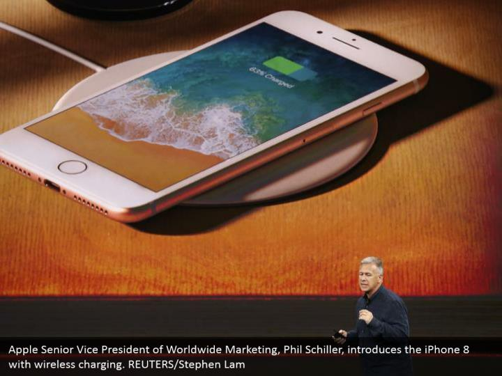 Apple Senior Vice President of Worldwide Marketing, Phil Schiller, introduces the iPhone 8 with wireless charging. REUTERS/Stephen Lam