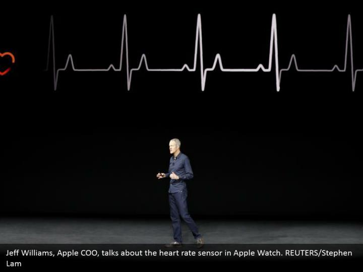 Jeff Williams, Apple COO, talks about the heart rate sensor in Apple Watch. REUTERS/Stephen Lam