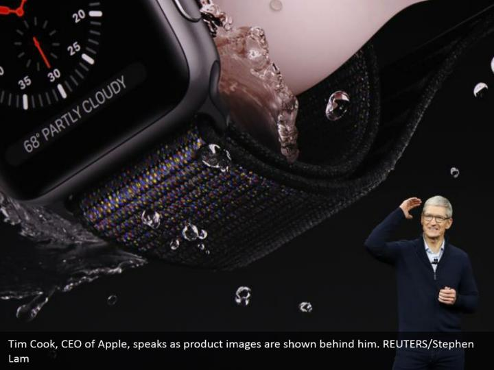 Tim Cook, CEO of Apple, speaks as product images are shown behind him. REUTERS/Stephen Lam