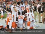 members of the cleveland browns kneel during