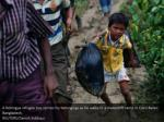 a rohingya refugee boy carries his belongings