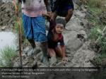 a rohingya refugees boy falls as he walks