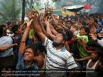 rohingya refugees reach out their hands to grab