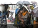 rohingya refugees stands in an open place during