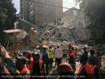 people clear rubble after an earthquake 1