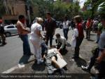 people help an injured man in mexico city reuters