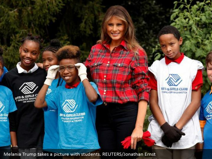 Melania Trump takes a picture with students. REUTERS/Jonathan Ernst
