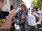 milo yiannopoulos walks while being escorted away