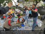 volunteers distribute water and other donated