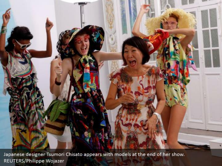 Japanese designer Tsumori Chisato appears with models at the end of her show. REUTERS/Philippe Wojazer