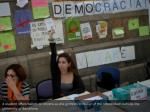 a student offers ballots to citizens