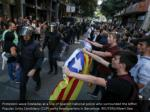 protesters wave esteladas at a line of spanish