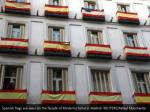 spanish flags are seen on the facade of moderno
