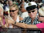 hugh hefner and guests toast one another as they