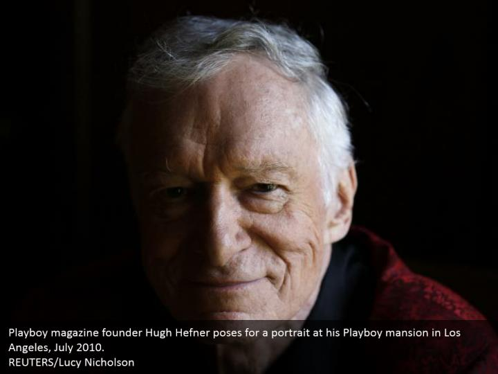 Playboy magazine founder Hugh Hefner poses for a portrait at his Playboy mansion in Los Angeles, July 2010.  REUTERS/Lucy Nicholson