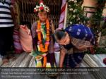 a hindu devotee takes blessings of a girl dressed
