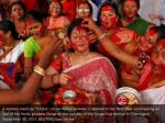 a woman reacts as sindur or vermillion powder