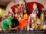 a woman worships a girl dressed as a kumari