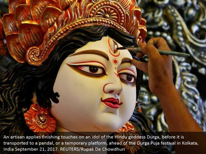 An artisan applies finishing touches on an idol of the Hindu goddess Durga, before it is transported to a pandal, or a temporary platform, ahead of the Durga Puja festival in Kolkata, India September 21, 2017. REUTERS/Rupak De Chowdhuri
