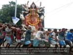 labourers carry an idol of the hindu goddess