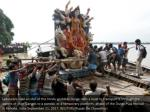 labourers load an idol of the hindu goddess durga