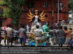 labourers prepare to load an idol of the hindu