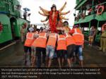 municipal workers carry an idol of the hindu