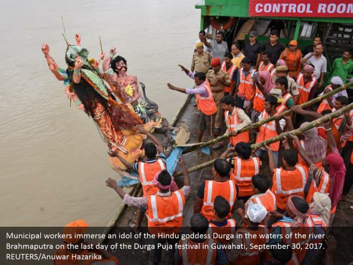 Municipal workers immerse an idol of the Hindu goddess Durga in the waters of the river Brahmaputra on the last day of the Durga Puja festival in Guwahati, September 30, 2017. REUTERS/Anuwar Hazarika