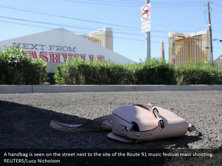 A handbag is seen on the street next to the site of the Route 91 music festival mass shooting. REUTERS/Lucy Nicholson