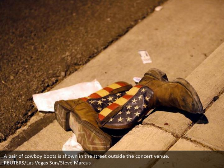 A pair of cowboy boots is shown in the street outside the concert venue.  REUTERS/Las Vegas Sun/Steve Marcus