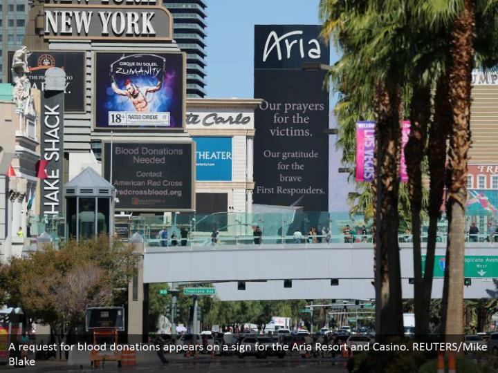 A request for blood donations appears on a sign for the Aria Resort and Casino. REUTERS/Mike Blake