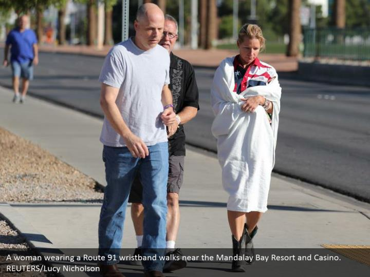 A woman wearing a Route 91 wristband walks near the Mandalay Bay Resort and Casino. REUTERS/Lucy Nicholson