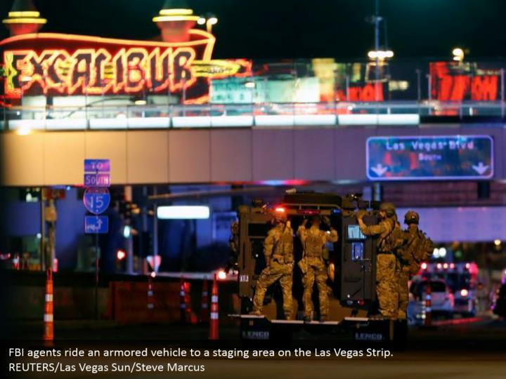 FBI agents ride an armored vehicle to a staging area on the Las Vegas Strip.  REUTERS/Las Vegas Sun/Steve Marcus