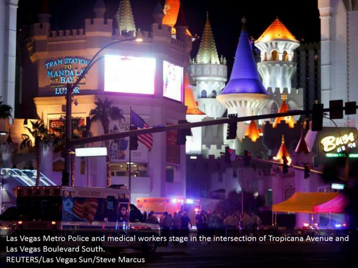 Las Vegas Metro Police and medical workers stage in the intersection of Tropicana Avenue and Las Vegas Boulevard South.  REUTERS/Las Vegas Sun/Steve Marcus